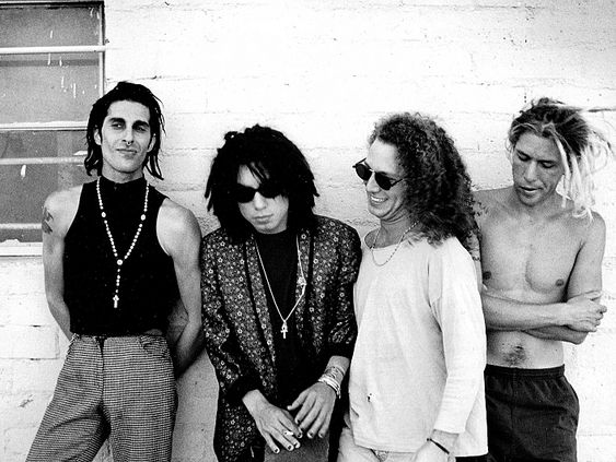 Members of rock group Jane's Addiction, photographed on Aug. 3, 1990. From left: Perry Farrell, Dave Navarro, Stephen Perkins and Eric Avery.