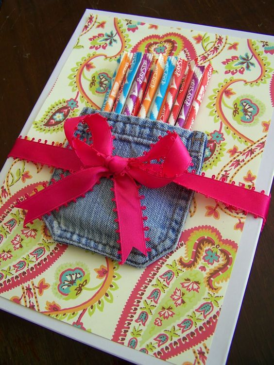 Scrapbook paper on a plain white t-shirt box with a old denim pocket and a ribbon... so cute!