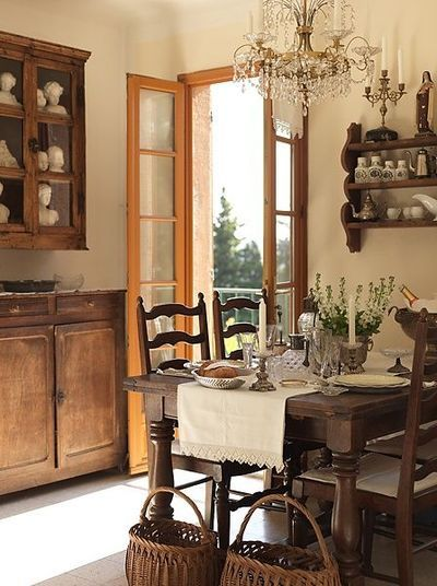 Best French country farmhouse kitchen decor with farm table, crystyal chandelier, and skinny French doors overlooking garden. #frenchfarmhouse #frenchcountry #kitchen #provence #elegant