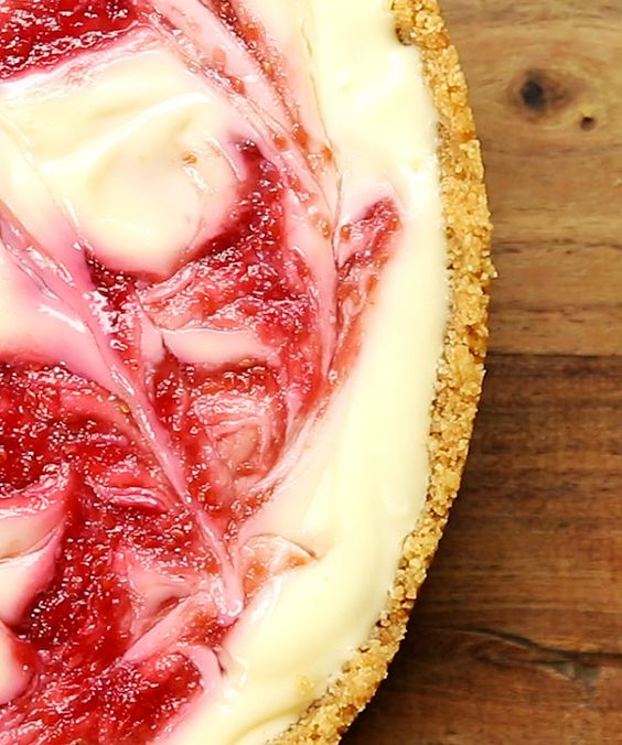 Raspberry Ripple 300 g digestive biscuits 125 g unsalted butter, melted 500 g cream cheese 1 387 g can condensed milk 1 teaspoon vanilla extract 300 g raspberries 30 g caster sugar 100 mL water