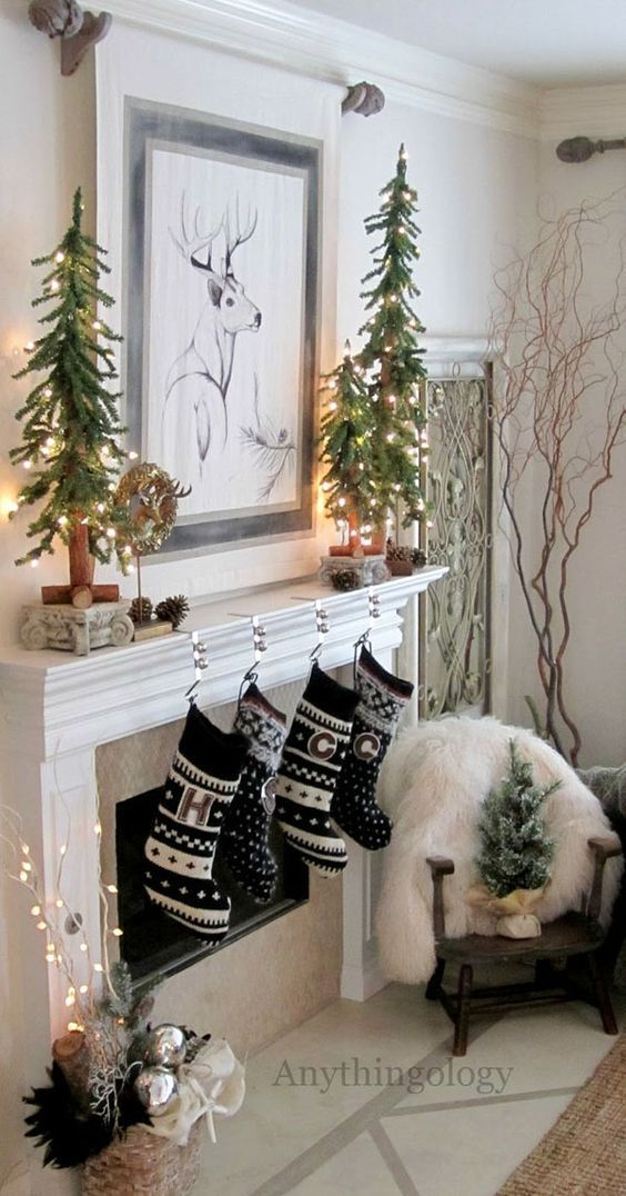 black and white stockings and lit up small trees on the mantel