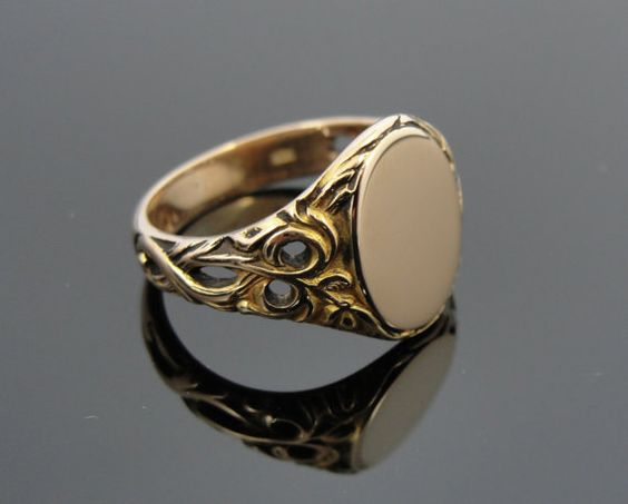 Art Nouveau Pierced Side, Ornate Signet Ring in Yellow Gold. Sweeping floral sides bring a touch of elegance and distinction to this vintage Signet ring. The metal is 14k Rose gold, making this tough and hard and easy to wear every day