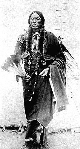 Quanah Parker, a Kwahadi Comanche chief; full-length, standing in front of tent. Photographed by            Lanney. Read EMPIRE OF THE SUMMER MOON.