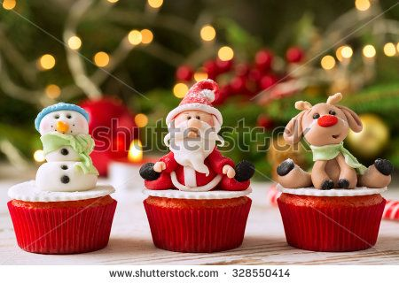 Three traditional decorated christmas cupcakes - stock photo