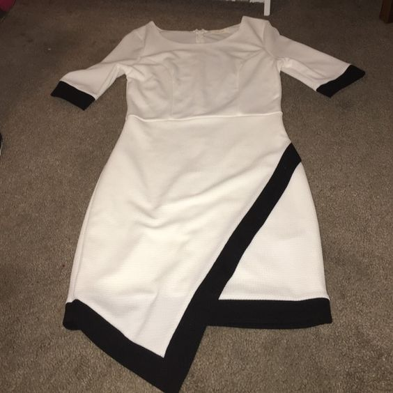 White with black trim dress ✨ Never worn. Didn't fit me right. Size large but fits tight ✨ Dresses Long Sleeve
