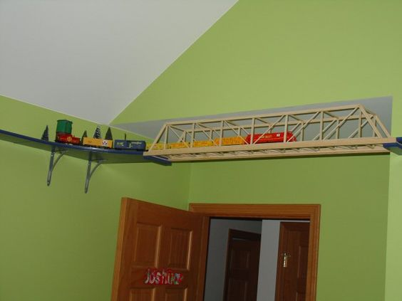 Model Train Running Along The Ceiling From Room To Room