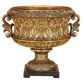 """Elegant Golden Decorative Bowl by Aspire: This large bowl has a very expensive look for a very reasonable price. The golden bowl is shaped like an antique goblet with scrolled handles on either side. Fleur de lis designs decorate the side of the bowl. The bowl is mounted on a brown wooden base. 15"""" x 13"""" x13"""""""