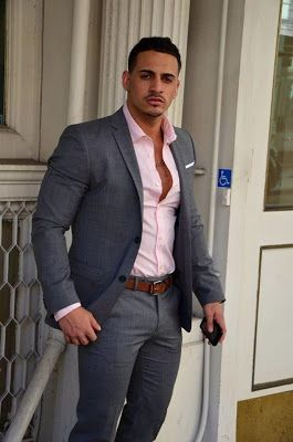 Grey suit with a slim modern cut, pale pink shirt and brown belt