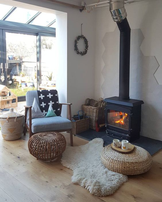 Fireplace with hexagonal tiles in the living room Pic @aliceinscandiland