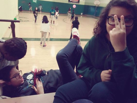 ash is the one on the phone wearin glasses and kimberly is the one doing a ✌