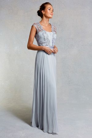 A truly stunning maxi gown perfect for any extra special occasion. The Lori Arlie Maxi Dress features wide embellished sheer straps which overlay the gorgeous ruched bodice. The waist is cinched with a lustrous waist tie which creates a stunning silhouette. The pleated skirt elongates your figure beautifully and is fully lined for party perfect movement. 154cm/60.6inches from side neck point to hem.