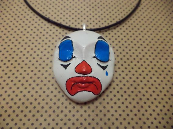 OOAK Hand Painted Creepy Sad Clown Carnival Necklace. $40.00, via Etsy.