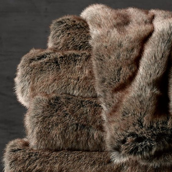 Rank & Style's Talking Top Tens - Jamie Lewin's Ten Essentials: Restoration Hardware Luxe Fur Throw #rankandstyle #talkingtoptens #influencers #inspiration #giftideas https://www.rankandstyle.com/talking-top-10/20141208/jamie-lewin/