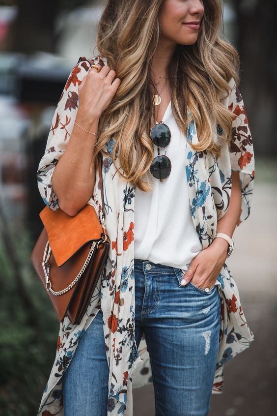 It's no secret I love a good kimono. You've seen me sport this one on Instagram and I am also loving this white floral kimono. I think it look great with jeans, shorts, over a slip dress, or even as a swim coverup. The colors in this Boho Kimono from Anthropologie are actually perfect for both … #BohoFashion