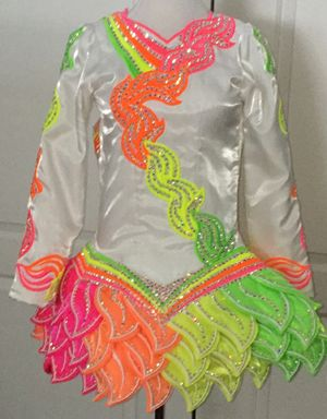 Beautiful white and neon solo dress. Show stopping on stage, a real eye catcher.