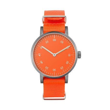 Brushed Round Basic with Orange Nylon Strap & Orange Dial by VOID Millennial Watches -  Swedish designer David Ericsson is the mastermind behind these deceptively minimal men's accessories. Designed with interstellar inspiration and constructed with superior standards, this underground brand is quickly becoming a powerhouse. $150 !!