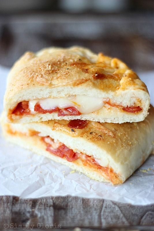 Homemade Stuffed Pizza Pockets are made with an easy homemade pillowy dough and baked with your favorite pizza toppings all up inside.  These heavenly pizza pockets are brushed with a gar...