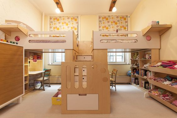 Two loft beds sharing a central staircase 8 Cool Kids Rooms Your Children Wont Mind Sharing