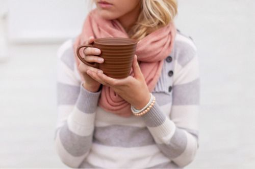 Sweater, scarf, a cup of coffee - good for chilly mornings.