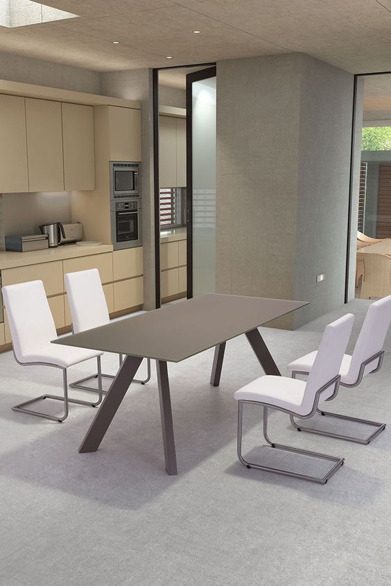 The Emard dining table consists of a painted steel frame with a painted tempered glass top. Emard comes in three colours Iron, Mocha and White.