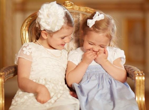 "Princess Madeleine of Sweden shared a photo showing cousins during the Prince Oscar's Christening Ceremony on Facebook page. The two young Princesses are shown hugging sitting together on a chair back at the Royal Palace after Prince Oscar's christening on Friday. ""My sister and I are blessed as mothers with two sweet little girls who adore each other!"" Princess Madeleine captioned the photographs."