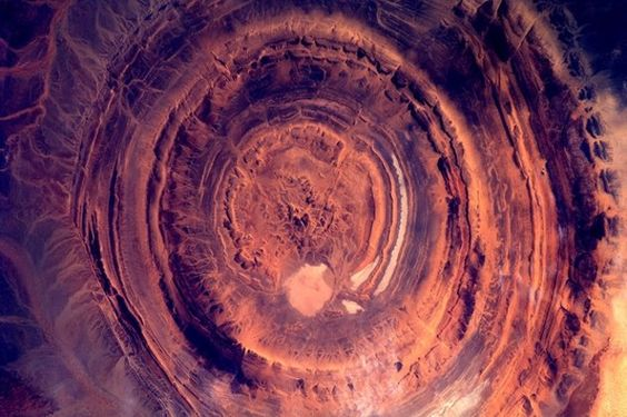 Dutch astronaut Andre Kuipers snapped this hypnotic image of the so-called Richat structure in Mauritania, as the space station flew over the Sahara Desert on the Atlantic Coast of West Africa. Erosion of the various rock layers created the ring-like features that make up the sprawling structure, but the origin of the Richat structure remains somewhat mysterious, geologists have said.