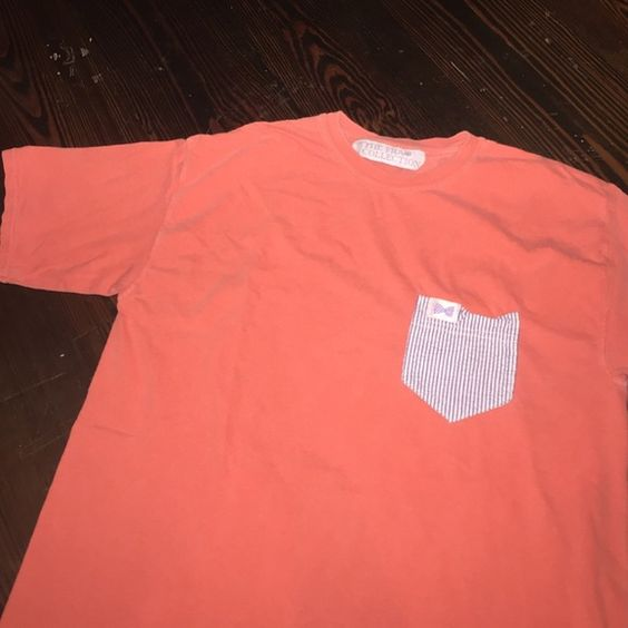 The Frat Collection Orange short sleeve t shirt Has sear sucker pocket !! Super cute!!! Really soft and comfy The Frat Collection  Tops Tees - Short Sleeve