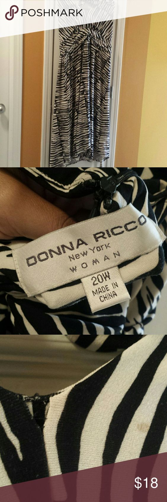 Size 20W Donna Ricco halter dress Black and white halter dress. Has a small stain and slight tear as indicated in photo. Price reflects such. Donna Ricco Dresses