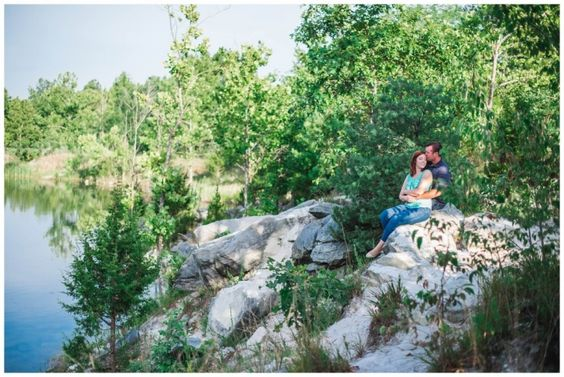 Anniversary love photo session at Klondike Park in Augusta, Missouri, pictures on rocks with water and trees www.cindyleephotography.com