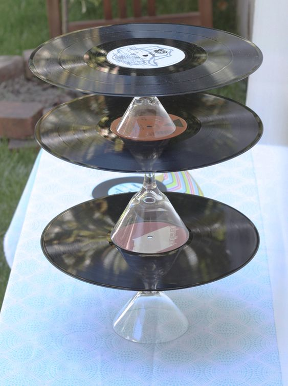 Hot glue martini glasses to records and you have a 3-tiered cupcake stand!