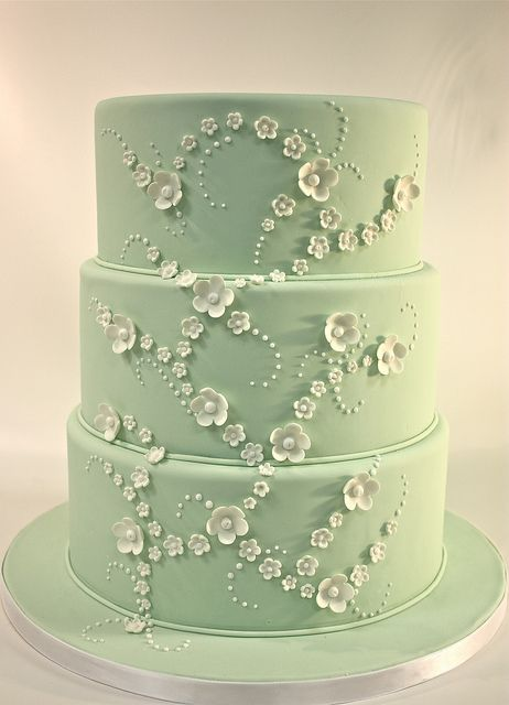 I love this cake, the color, how each of the tiers is so close in size, the flower placement and the dots... it almost looks like the flowers are moving.