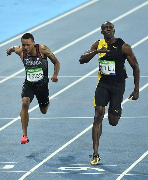 Canada's Andre De Grasse and Jamaica's Usain Bolt compete in the Men's 100m…