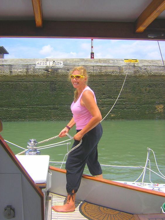 """Joell, using her professional line-handling skills in the Miraflores lock, Panama Canal, aboard trimaran Ladyhawke. An intense job requiring total concentration--it can be dangerous due to backwash & extreme currents and the heavy """"monkey fists"""" that are tossed from the handlers ashore. Like us on fb: https://www.facebook.com/EveryoneSaidIShouldWriteABook"""