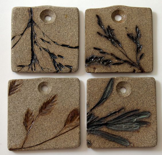 """Stoneware Pendants, embossed with native Missouri grasses, 1.75"""" x 1.75"""". Only grass imprint is glazed. Cone 6, NorthStar Pottery"""