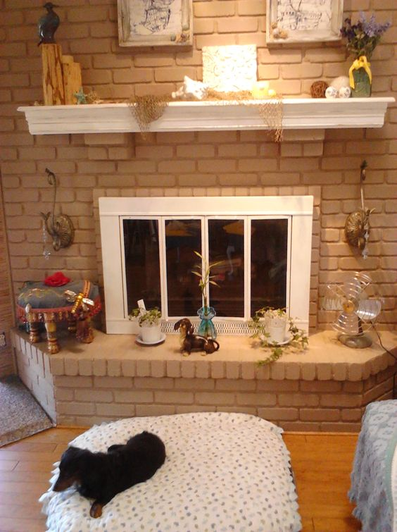 My fireplace area...DONE...all the items are thrift store/Ebay/Rescued Treasures Charity Boutique items...Even Mookie the dog is a Rescue...saved from a Puppy Mill