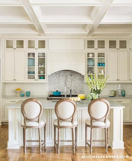 Ivory kitchen features ivory shaker cabinets paired with marble ...