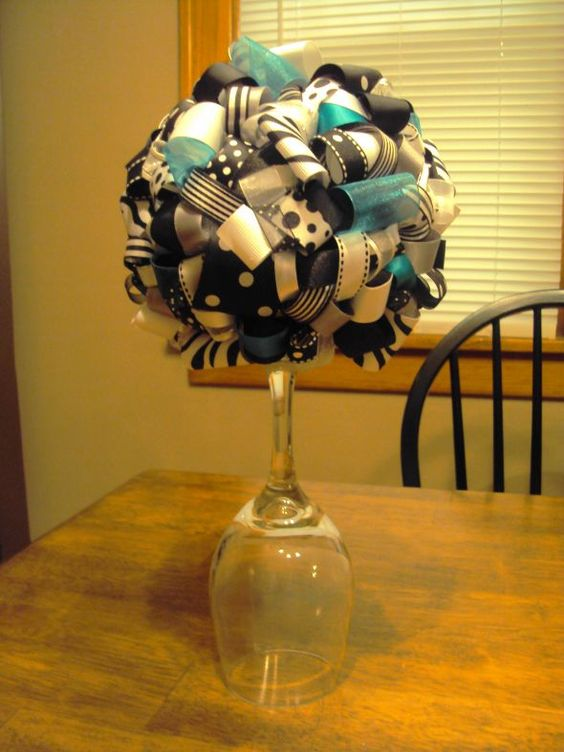 Centerpieces ribbons and ribbon topiary on pinterest for Centerpieces made with wine glasses