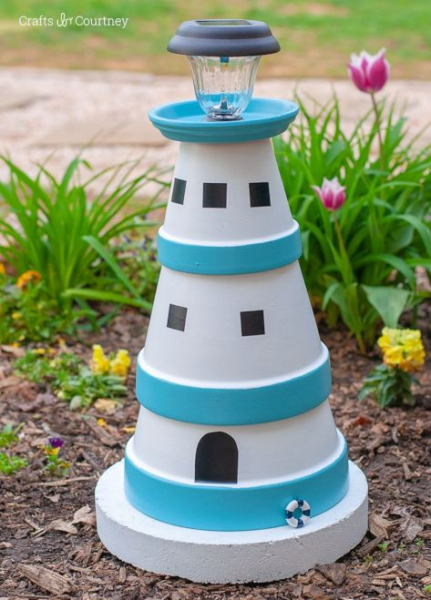 Make a Clay Pot Lighthouse with a Solar Light (or without) for your Garden, Entryway or even the Porch. It will bring unique Nautical Curb Appeal to your Home. Fun Summer Craft too! Featured on Completely Coastal. Links to DIY Terra Cotta Clay Pot Lighthouses!