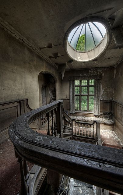 derelict stairwell of grand building... of glamourous ladies sweeping down to a ball...and maids plodding up & down at the masters beck and call....these could tell some stories!