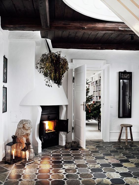 not sure if this was a foyer, but I love the idea of a fireplace being near an entry... very inviting. love the tile, white walls, dark ceiling mixture.