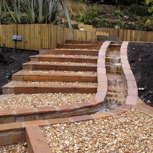 Garden steps with drainage down the side backyard for Step up garden designs