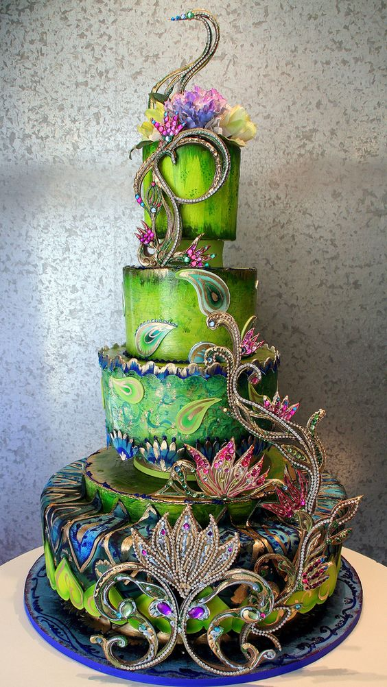 "Stunning Indian themed wedding cake in peacock colors. ""Samsara"" by Rosebud Cakes."