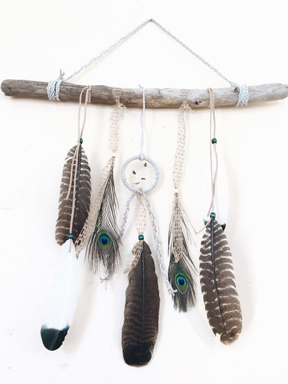 """The ultimate boho chic piece for any Gypsy Soul, adding  a natural, rustic touch to any room decor!  This handmade piece features a 3"""" white leather dreamcatcher with beautiful stones and a lovely mixture of wild turkey & peacock feathers with braided leather & tweed. And of course, a large piece of driftwood handpicked off the shores of Lake Erie."""