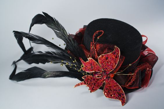 Love the beaded butterfly. I bet I could make them as well. Also love the red and the black! Go figure. :)