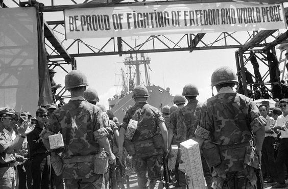 Banners of appreciation from the Vietnamese decorate the dock at Danang where a farewell ceremony was held by the Vietnamese Government for departing Marines of the 1st Battalion/9th Regiment, July 14, 1969.