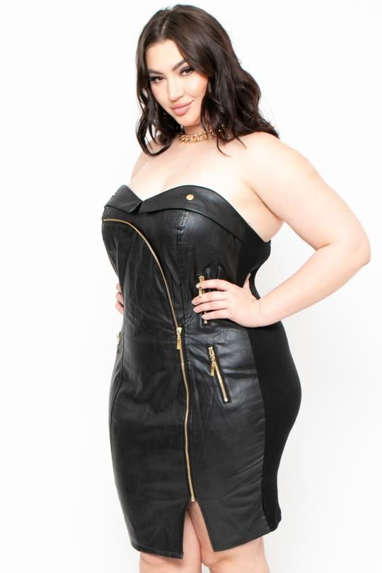 This plus size, dual material dress features a faux leather front and a woven stretch back, a sweetheart neckline, lined padded cups, paneled seams, mock front zipper pockets, elasticized back, partial smocked back with an exposed zipper, and a bodycon silhouette.    Content + Care 85% PU, 10% Cotton, & 5% Spandex