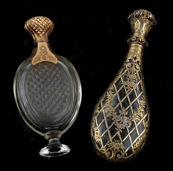 A 19th century French silver gilt mounted scent bottle & a 14kt gold scent bottle