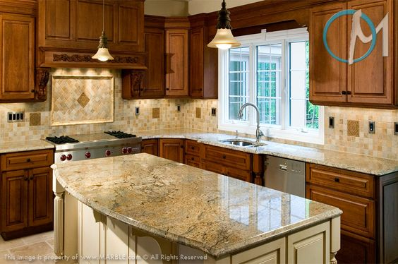 Moderate color to these cabinets works well with a darker slab of this granite. It helps draw out the browns and other colors that really make this a beautiful and unique piece.
