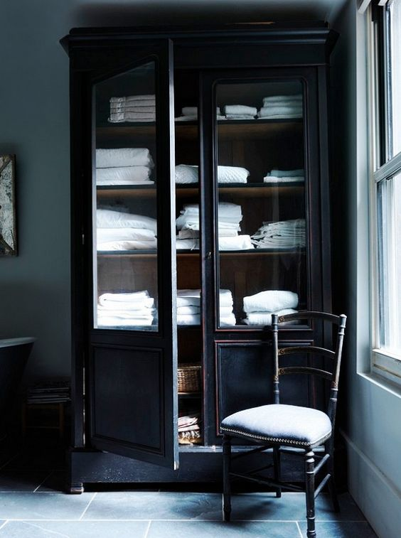 Bathroom armoire with linens and towels.