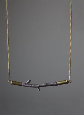string + twig by Cursive Design (Chicago-based jewelry line founded by Sarah Fox in 2006 )